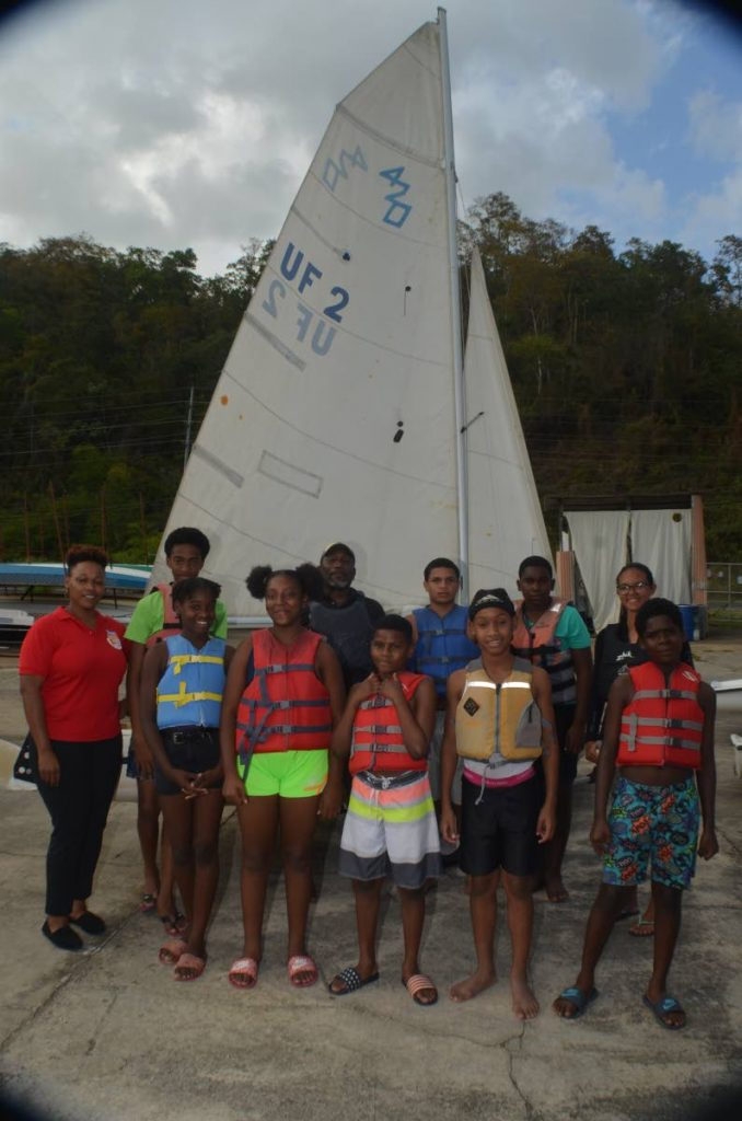 Members of the Carenage Youth Club stand alongside assistant leader WPC Chantelle Portillo (L) and trainers Earl Tobias (C) and Katherine Christopher (R). - Photo courtesy Carenage Police Youth Club
