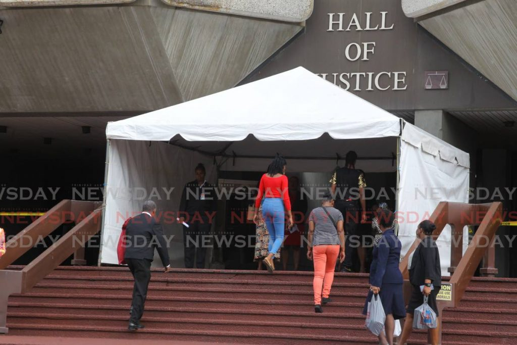COVID19 SCREENING AT THE COURT: Security officers screen members of the public, attorneys and staff of the Judiciary, as part of the Judiciary's covid19 policy. - ROGER JACOB