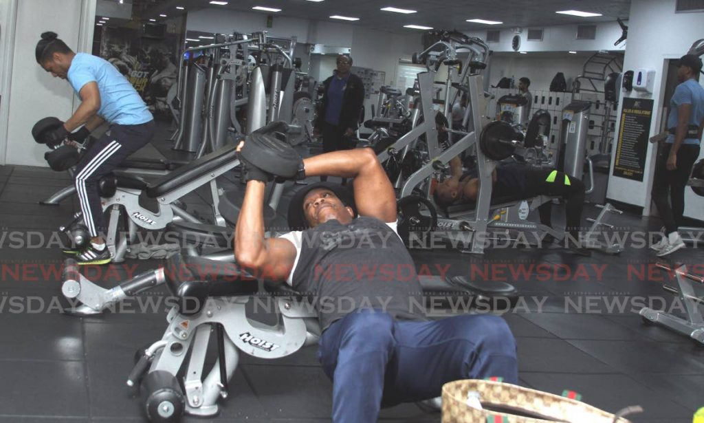 People work out at D'Dial Fitness Club, on Monday.  - Ayanna Kinsale