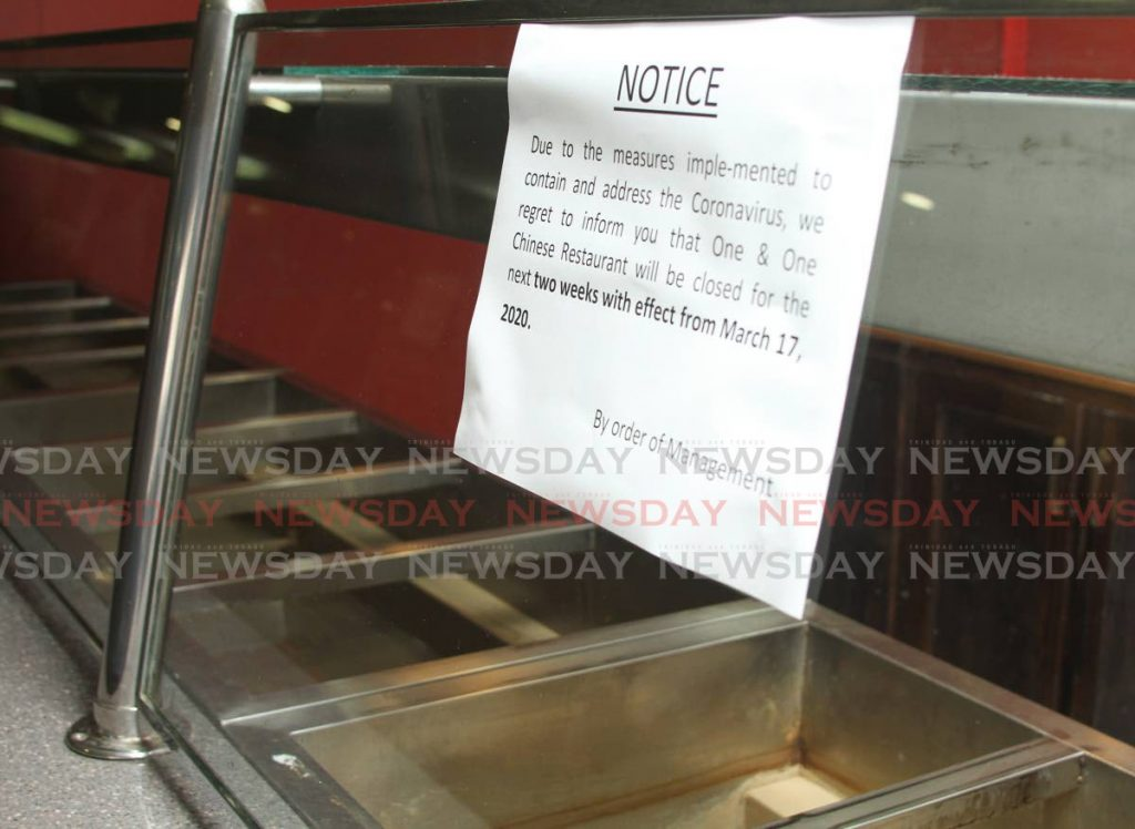 A notice one of the booths at Nicholas Tower food court on march 17 advises customers that the business would be closed for two weeks because of the response to the threat of covid19. - Ayanna Kinsale