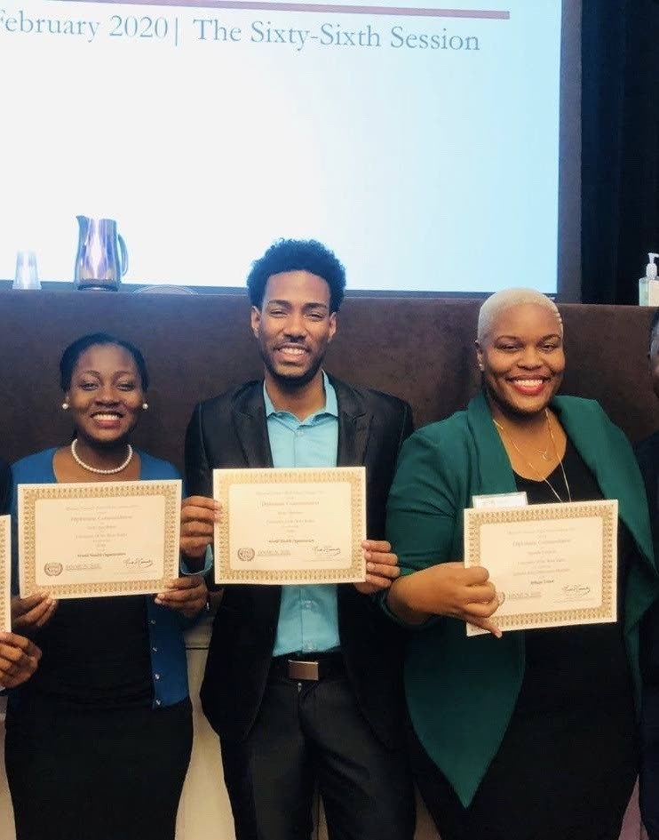 Joneille Johnson, left, Dr Ryan Abraham and Terriann Baker, delegates from The UWI St Augustine campus Institute of International Relations, celebrate after winning commendations in the 2020 Harvard National Model United Nations. -