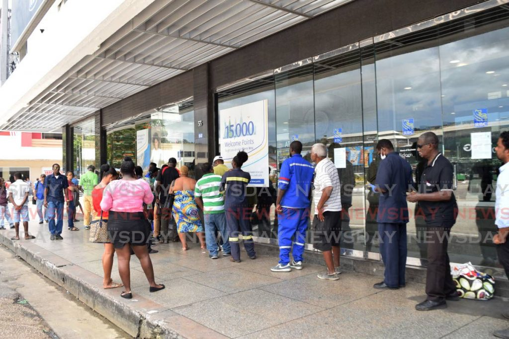People line up outside the Independence Square branch of RBC as precautionary measures have been put in place to prevent the spread of covid19.   - Vidya Thurab