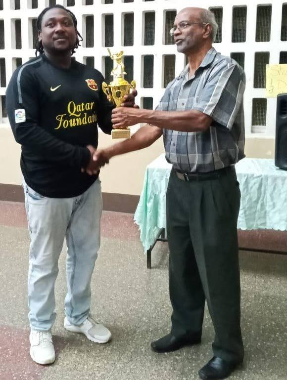Steffon Pemberton, left, collects the Rovers Sports Club Cricketer of the Year trophy from Arjoon Ramlal, first vice-president of the TT Cricket Board.  -