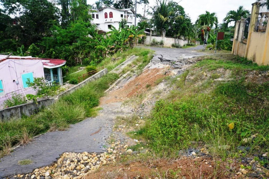 SLIPPING: The Ramgobin's home at Tin Pan Alley, Barrackpore, at left is slipping and is unsafe.  -