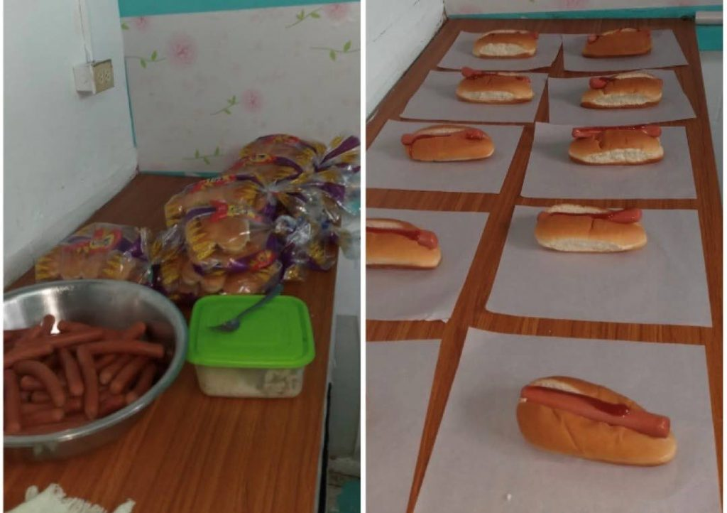 Hot dogs being prepared to distribute to Siparia children -