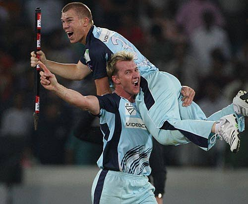 Brett Lee hoists David Warner in celebration after defeating TT Red Force in the final. -