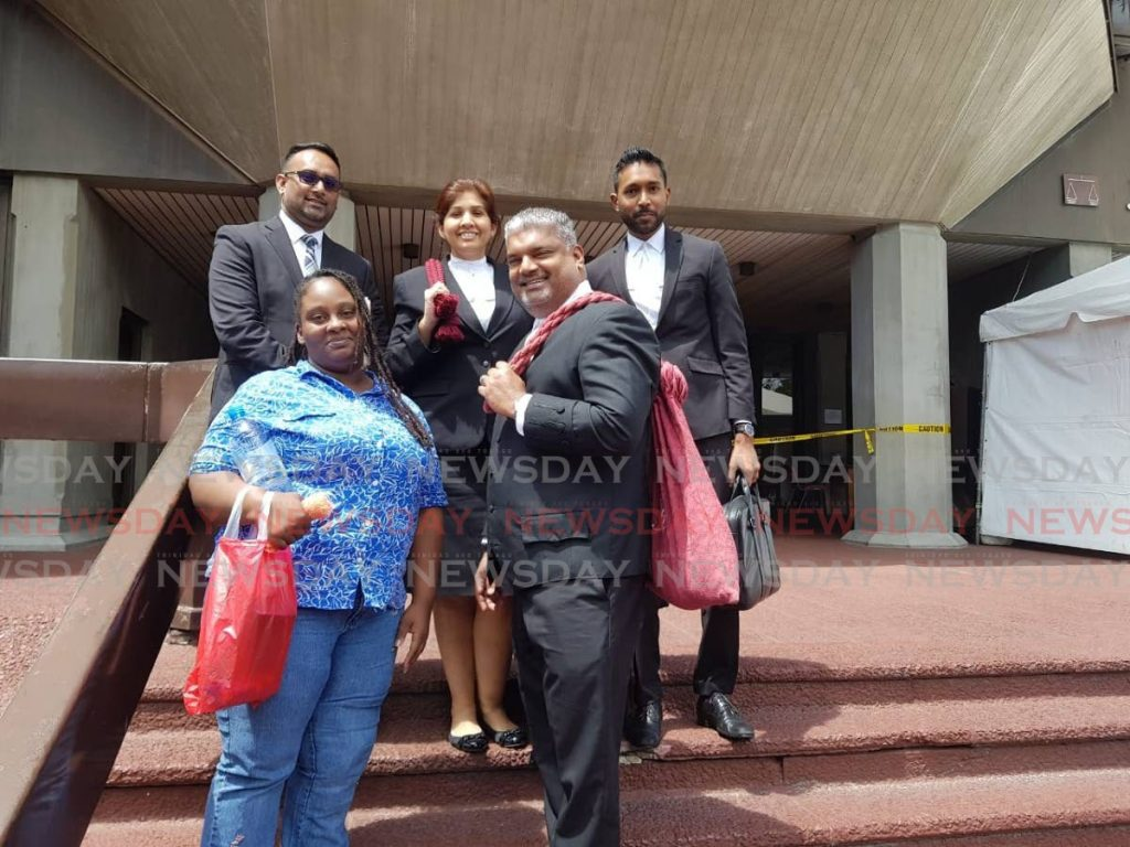 FREED: Alicia George, left bottom row, and her attorneys Anand Ramlogan,SC, Alvin Pariagsingh, left upper row, Jayanti Lutchmedial and Ganesh Saroop outside the Hall of Justice, Port of Spain, after Justice Kevin Ramcharan ordered her immediate release from prison. - Jada Loutoo
