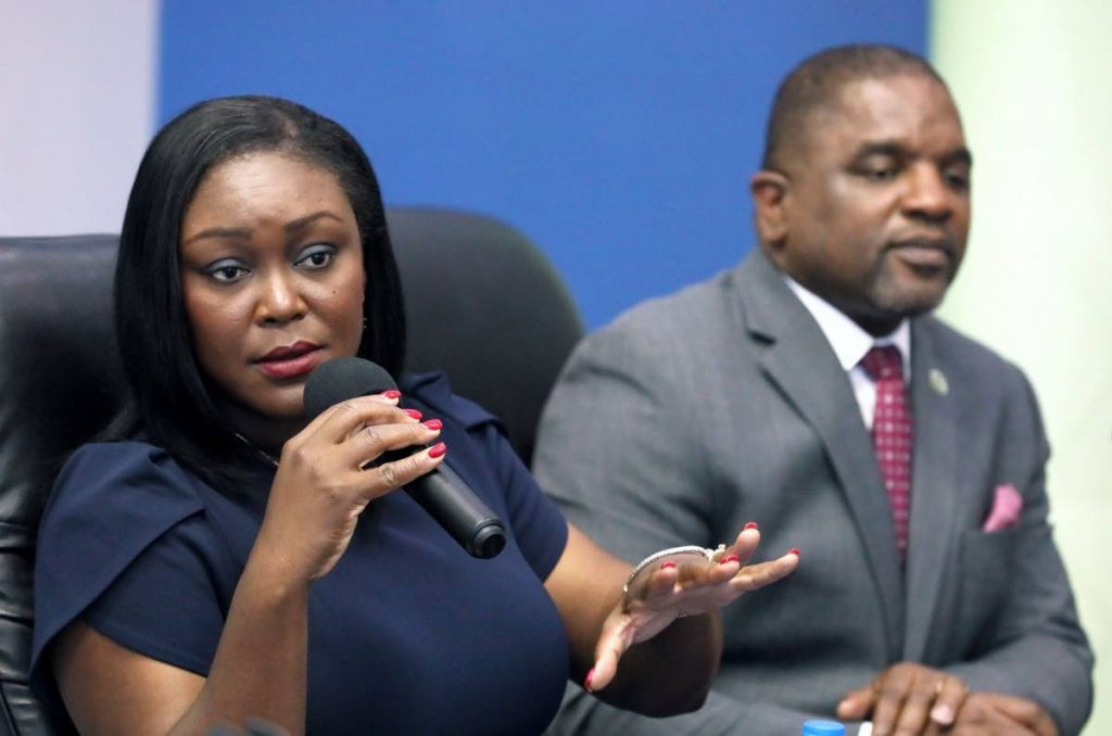 Health Secretary Tracy Davidson-Celestine, left, outlines some of the measures taken to deal with the covid19 pandemic at a press conference on Thursday in Scarborough. Also present was Finance Secretary Joel Jack. PHOTO COURTESY THA  -