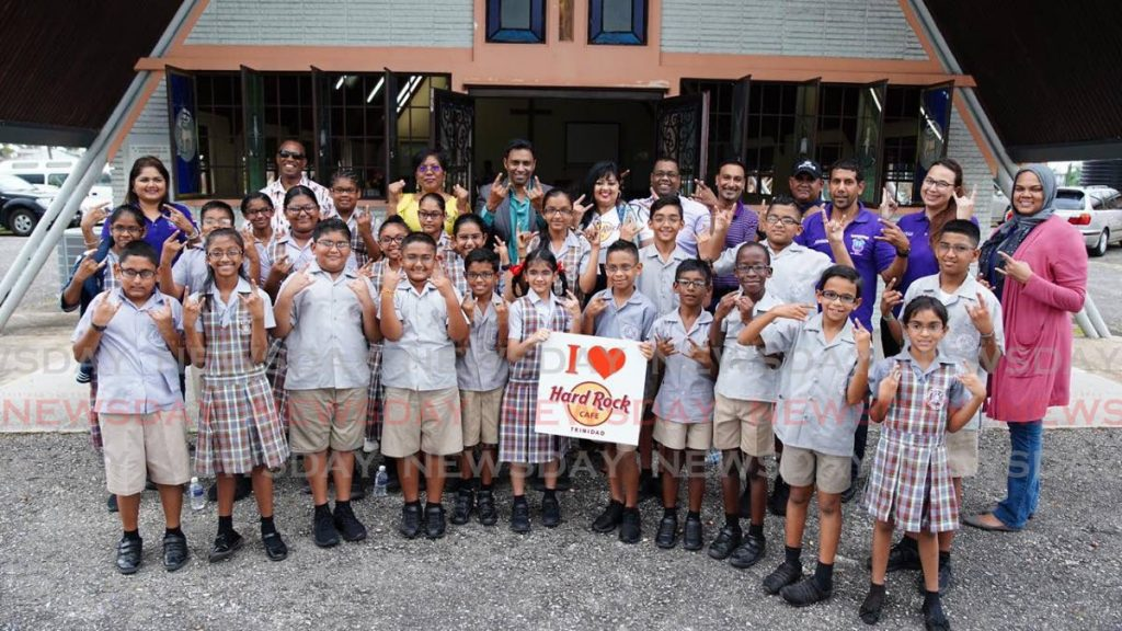 Students from Caanan Presbyterian Schools pose with their new glasses alongside with Sherry Persad, director of Hard Rock Cafe, TTPS' Brent Batson and president of Rapidfire Kidz Kevin Ratiram last Saturday. PHOTO BY CHEQUANNA WHEELER -