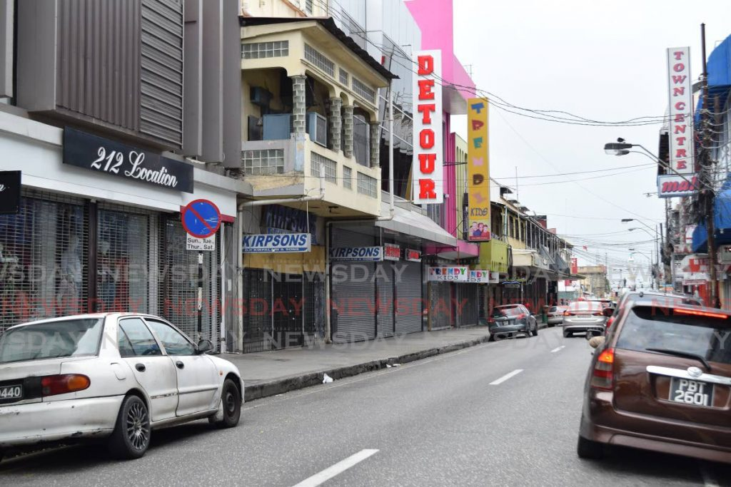 Stores on Frederick Street remained closed on Saturday as businesses heeded the call by authorities to venture out only when necessary to prevent the spread of covid19. - Vidya Thurab