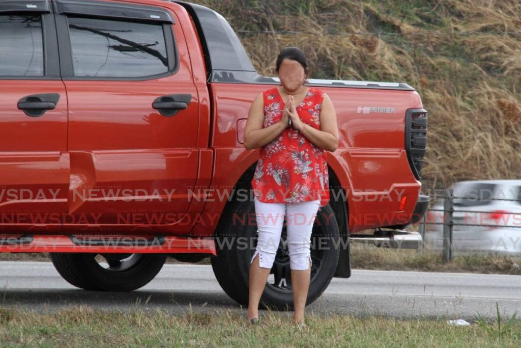The daughter of a 66-year-old covid19 patient prays outside the Couva Hospital and Multi-Training Facility where he is warded on Saturday. The photo has been blurred to protect her identity. PHOTO BY VASHTI SINGH -
