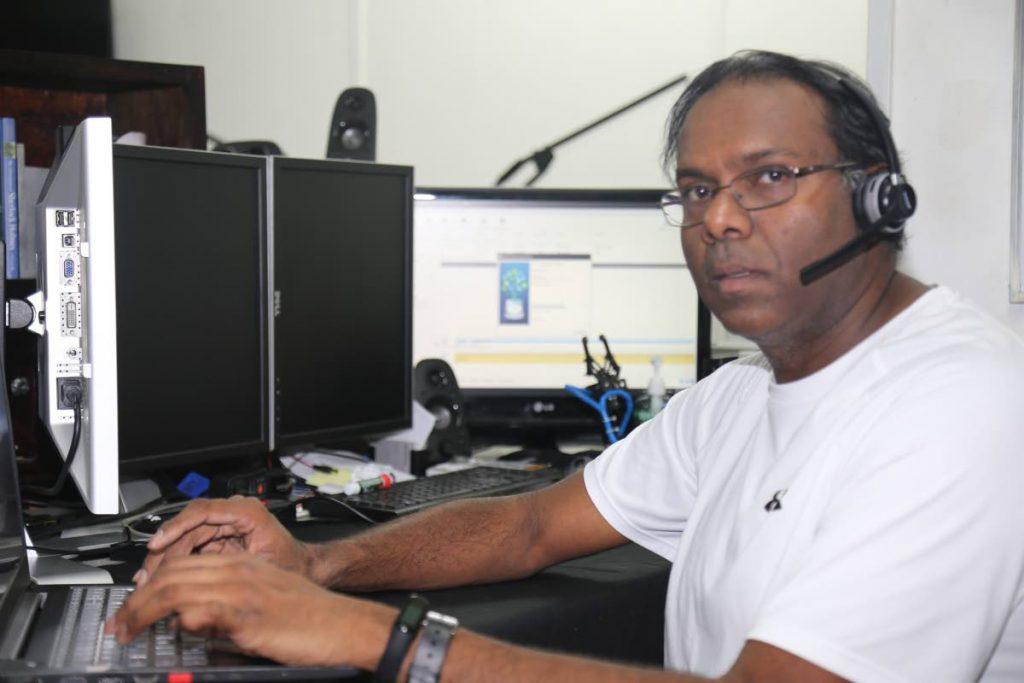 CIC computer science teacher Louis Ramdhanie at his home workstation.  -