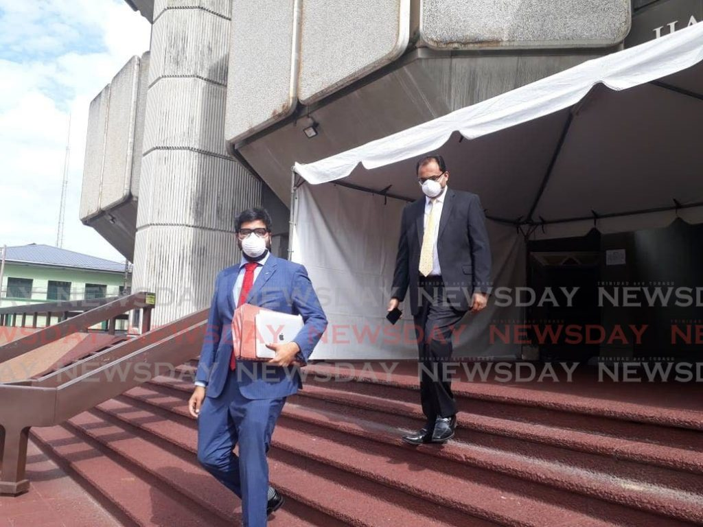 MASKED: Attorneys for Cedar Grove Primary School Stefan Ramkissoon, left, and Dinesh Rambally, leave the Hall of Justice, Port of Spain, on Monday after attending court. - Jada Loutoo