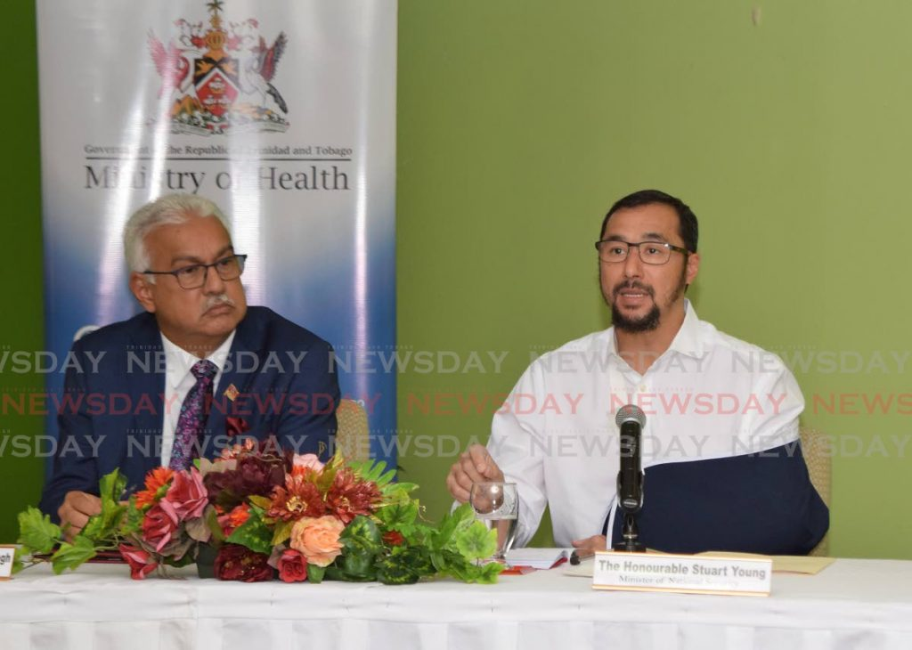 Minister of National Security Stuart Young, right, and Minister of Health Terrence Deyalsingh at a press briefing at the Ministry of Health on Tuesday. - Vidya Thurab