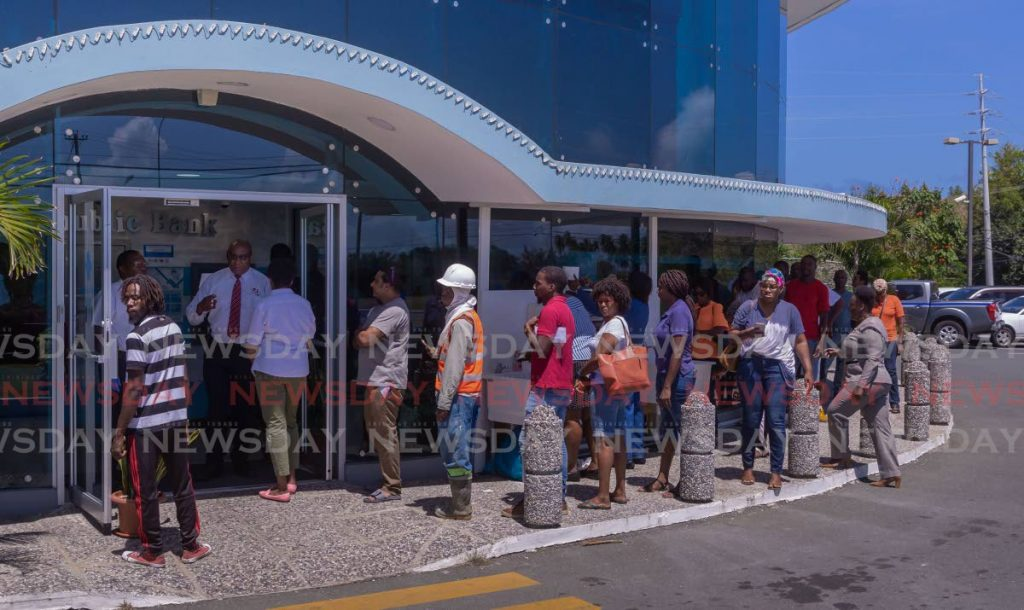 There were long lines at Republic Bank's Auchenskeoch branch on Friday as financial institutions had limits on the numbers of customers allowed inside at the same time. PHOTO BY DAVID REID  -