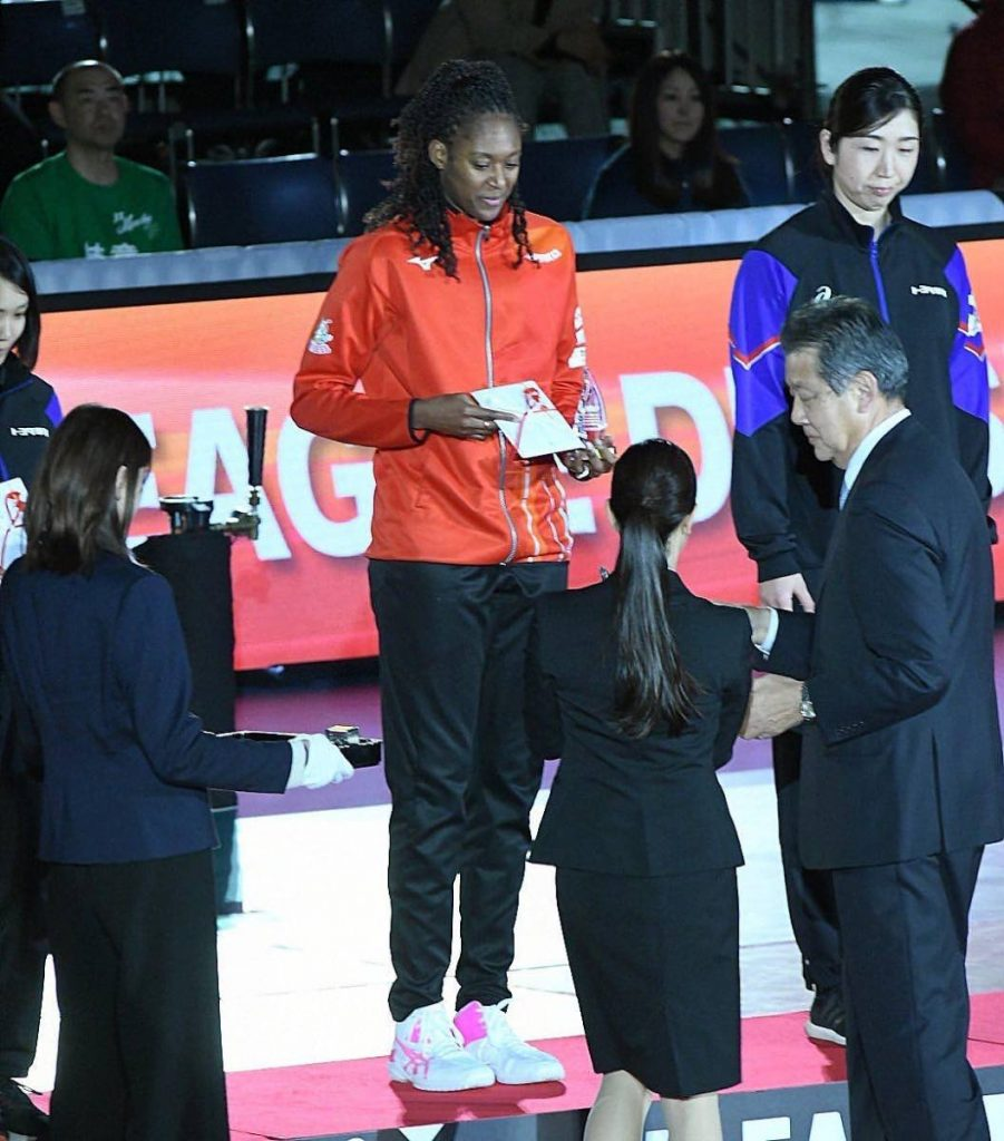 Sinead Jack-Kisal receiving the 'Best Six' award at the closing ceremony of the V-League, Japan. -