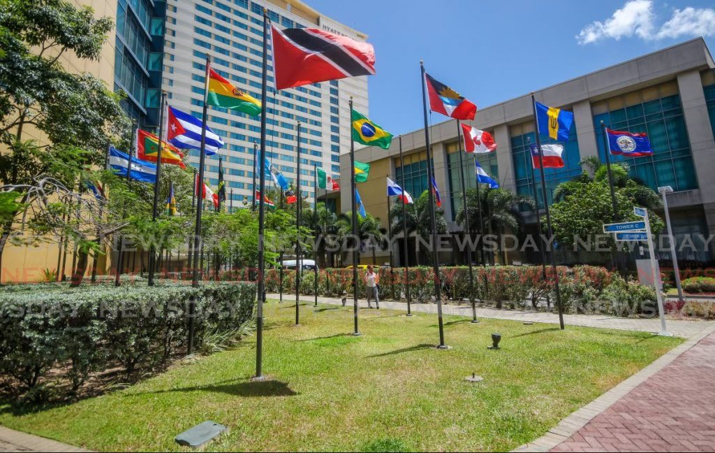 Country flags flying outside Hyatt Trinidad in Port of Sapin. - JEFF K MAYERS