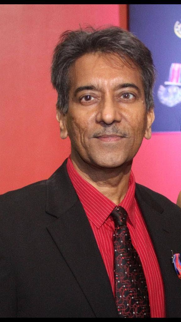 Dr Varma Deyalsingh,-