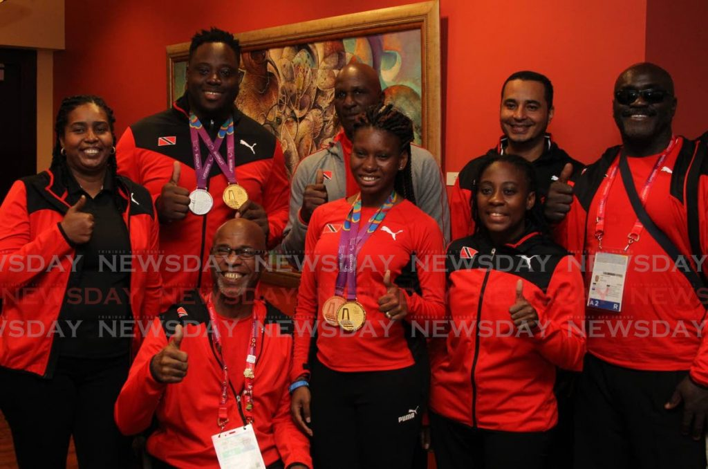 In this Sep 4, 2019 file photo, (from left back row) TerryAnn Evelyn (team manager), Akeem Stewart, coach Wade Franklyn, coach Edward Marchan and Carlos Greene pose for a photo alongside Dennis La Rose (front row from left), Nyoshia Cain-Claxton and Shanntol Ince after the team returned home at Piarco International Airport after representing the country at the 2019 Parapan games in Lima, Peru. PHOTO BY ROGER JACOB -