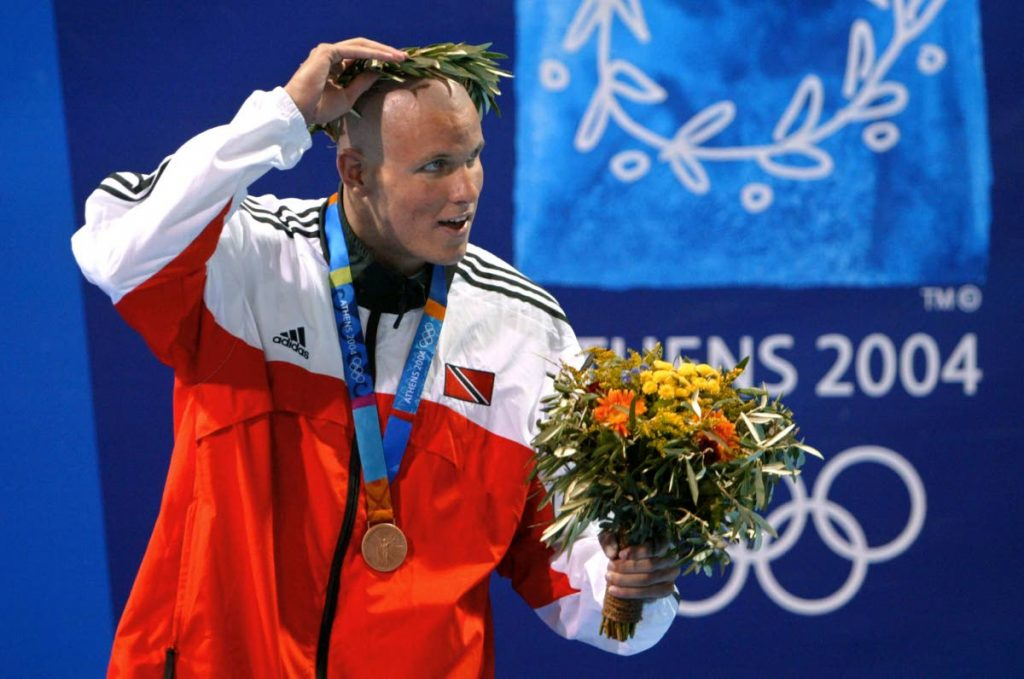 In this August 19, 2004 file photo, TT's George Bovell adjusts his crown after claiming the men's 200m individual medley bronze medal, at the 2004 Olympic Games at the Olympic Aquatic Center in Athens. (AFP PHOTO) -