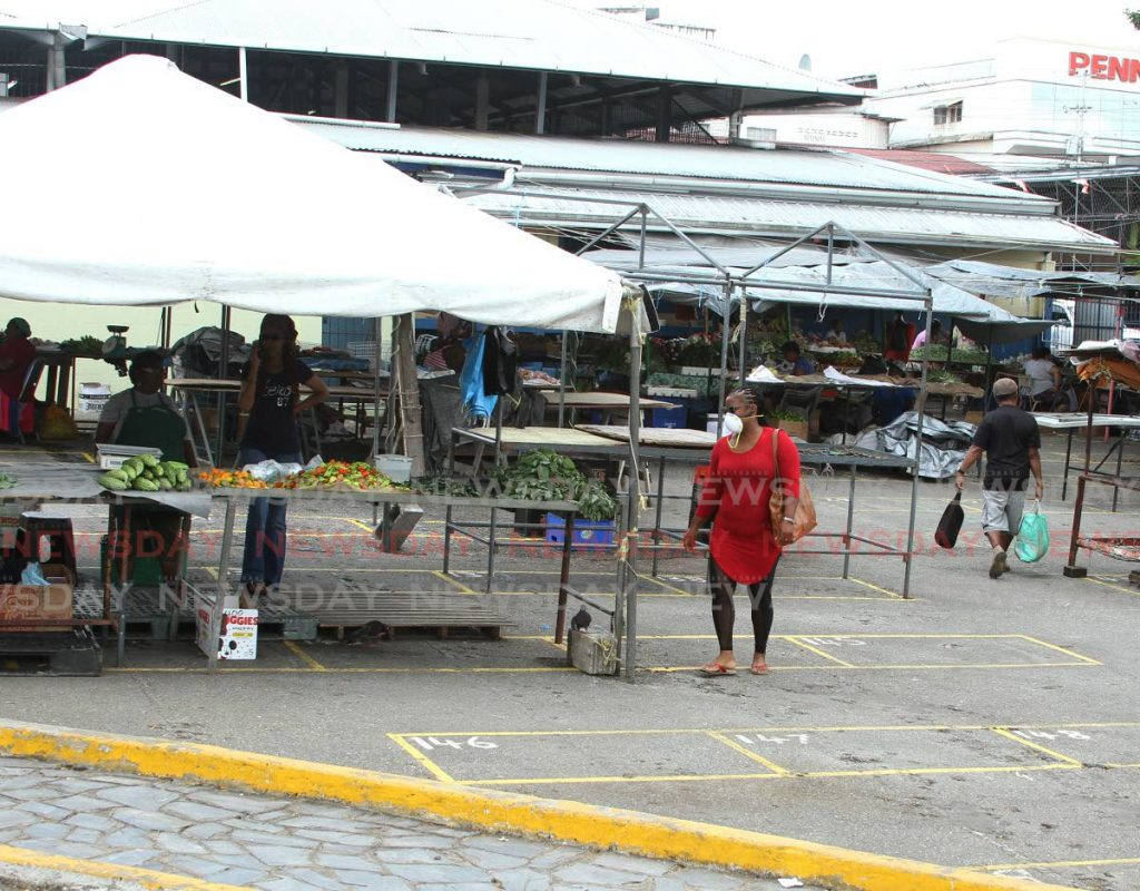 Customers at the Arima Market. Photo taken April 2, 2020. Ayanna Kinsale - Ayanna Kinsale