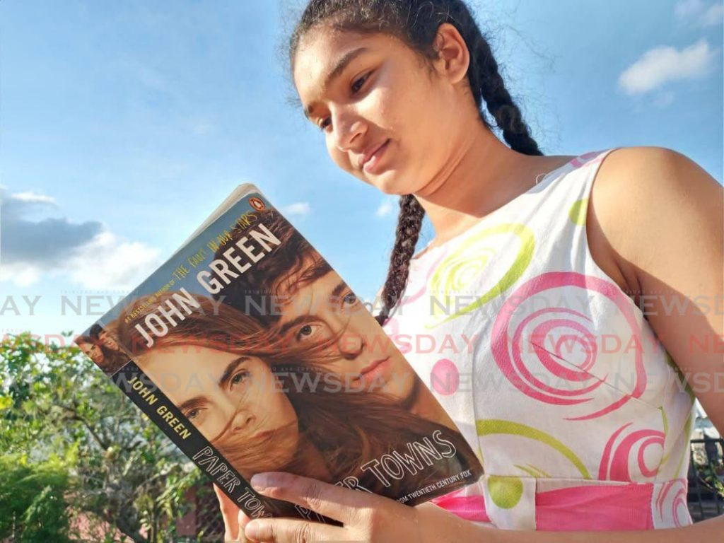 Nisha Mohammed reads Paper Towns by John Green. PHOTOS BY YVONNE WEBB -