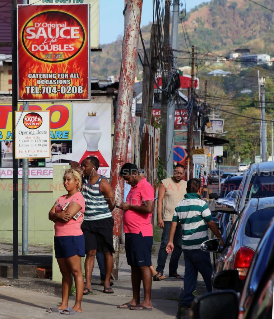 Customers line up at D'Original Sauce Doubles on the Eastern Main Road, Curepe. Photo: Sureash Cholai - SUREASH CHOLAI