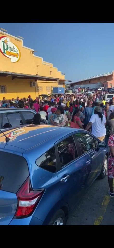 Shoppers crowd in front a grocery in Barbados on Friday after the government announced new measures to combat covid19. -