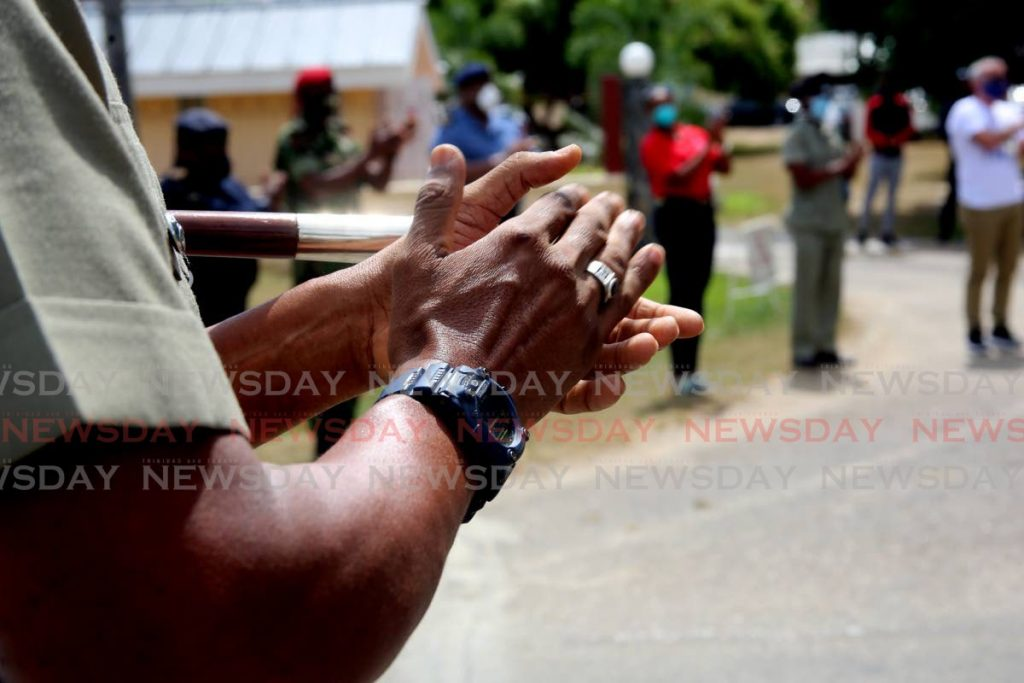 Workers of the ANSA McAL group of companies as they gathered outside the Police Academy in St James to salute essential workers on April 9. - SUREASH CHOLAI