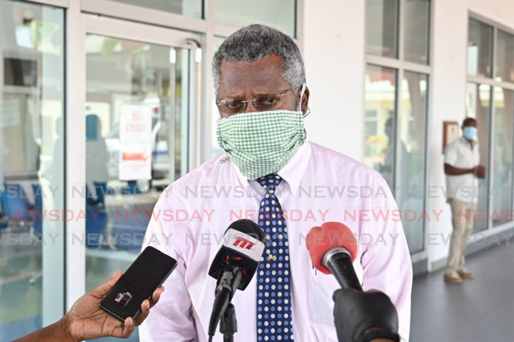 Acting Medical Chief of Staff at Scarborough General Hospital, Dr Victor Wheeler, wears a face mask as he speaks with reporters on Thursday.  - LEANDRO NORAY