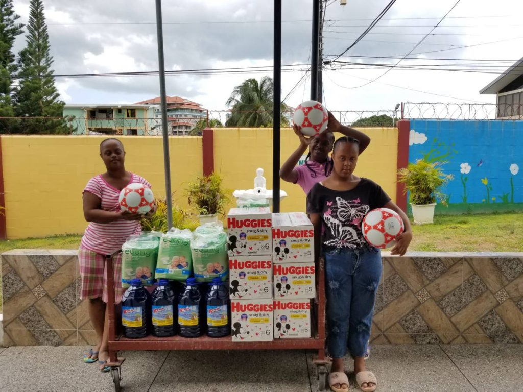 Residents at the Lady Hochoy Home pose with products donated to the home.  -