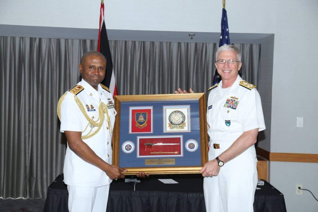 Former Chief of Defence Staff Rear Admiral Hayden Pritchard, left presents a gift to US Naval Admiral Craig Faller during Faller's visit to Trinidad in 2018.  PHOTO COURTESY TT DEFENCE FORCE - Shane Superville
