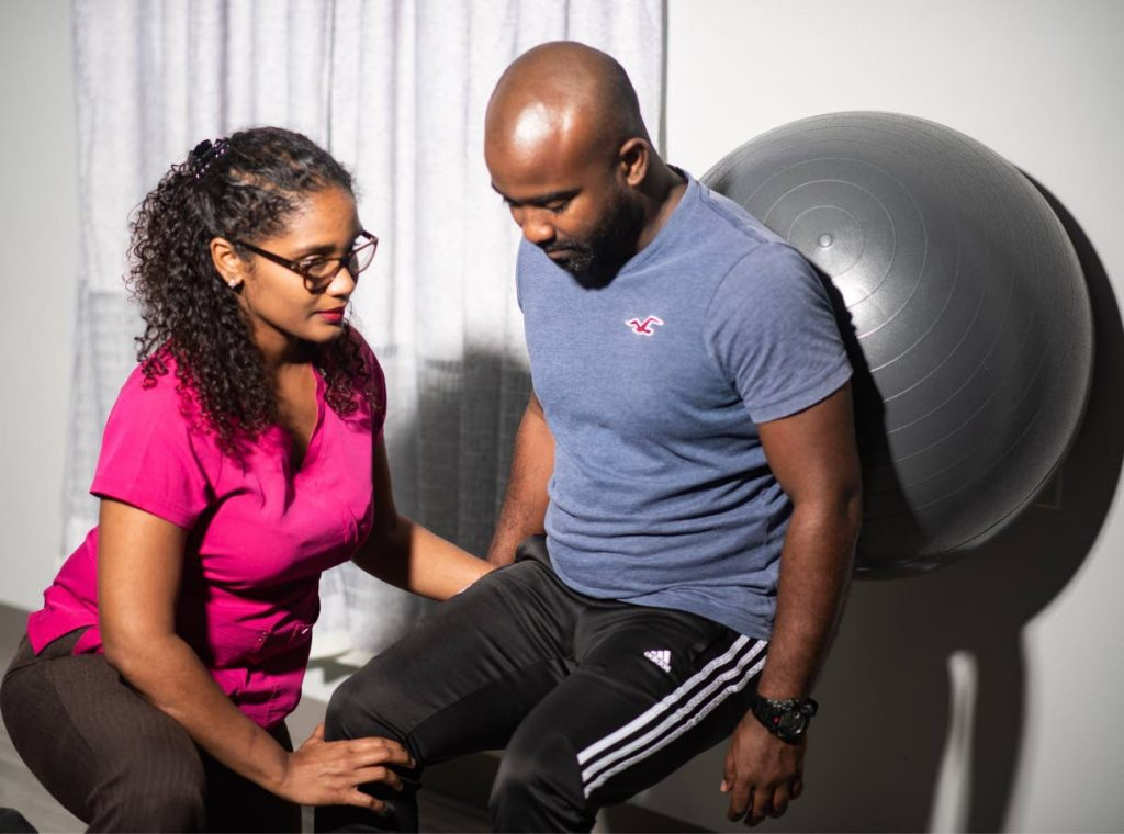 Physiotherapist Deniele Jack demonstrates an exercise with her brother Derron Jack. - Anthony Frection