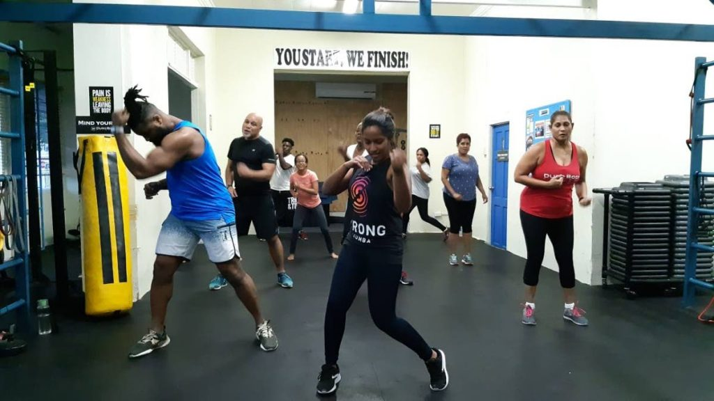 In this fie photo, members of the Duro Body Fitness club take part in a workout session at the club's headquarters, at Stone Street, Port of Spain. -