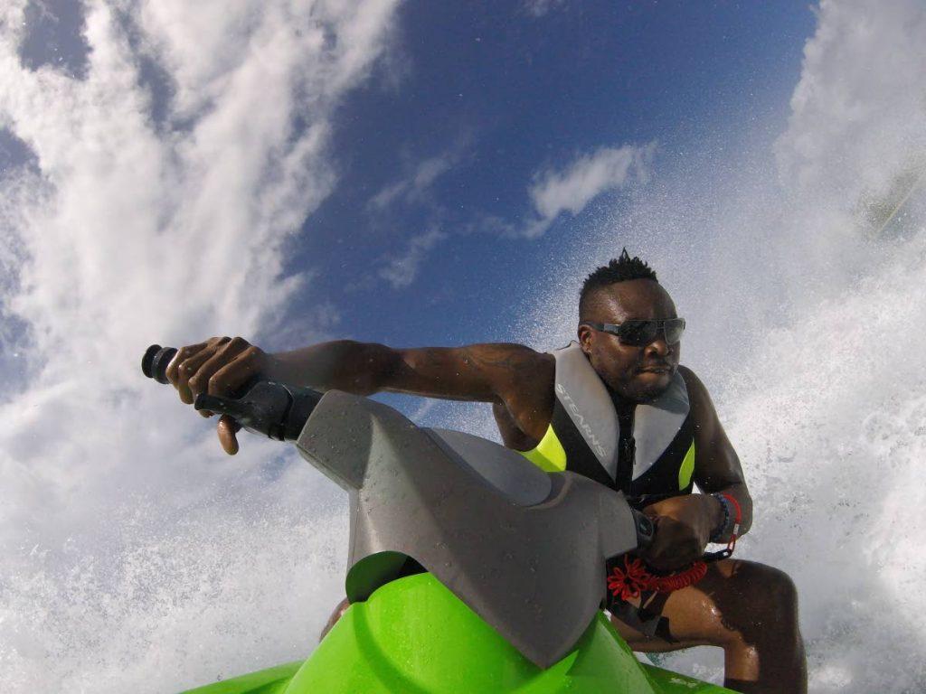 Waterholics founder Alex Nedd on a jet ski. -