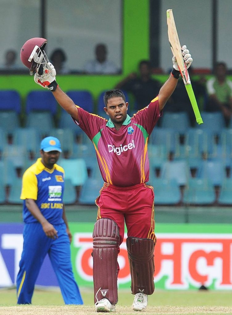 West Indies cricketer Adrian Barath celebrates after scoring a century (100 runs) during the first One Day International (ODI) cricket match between Sri Lanka and West Indies at the Sinhalese Sports Club (SSC) Cricket Ground in Colombo on January 31, 2011. West Indies captain Darren Sammy elected to bat after winning the toss against Sri Lanka in the opening one-day international.  - AFP PHOTO