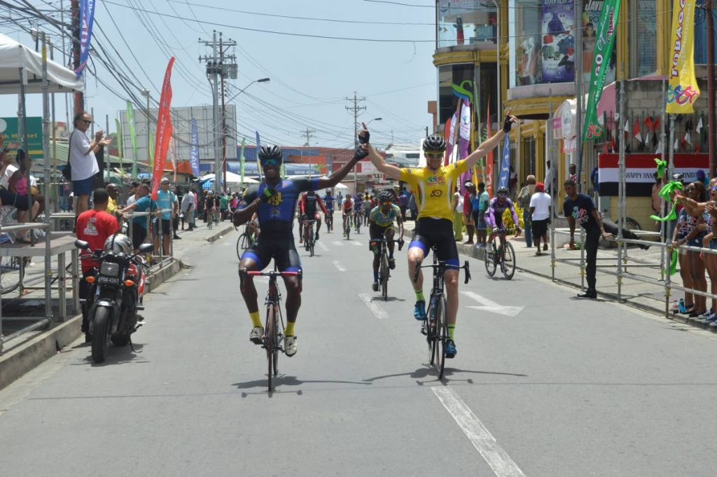 In this October 3, 2016 file photo, Jamaican Marloe Rodman (front left), and Dutchman Arno Van Der Zwet, raise their arms to celebrate victory in the Tobago International Cycling Classic sprint and division one stage titles.  -