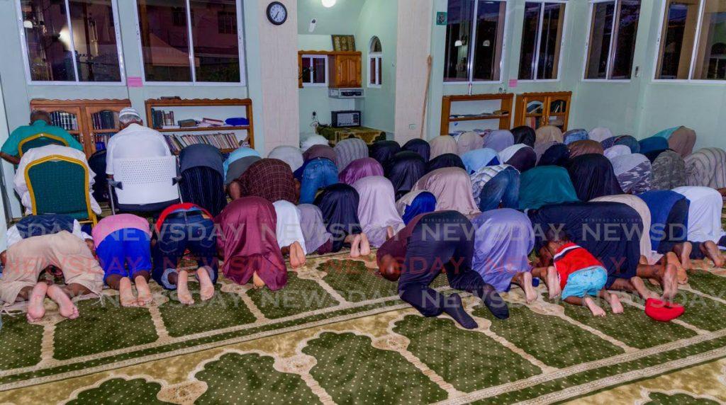 Muslims pray before they break fast at the Masjid Al Tawbah, Lowlands in 2019.  - DAVID REID