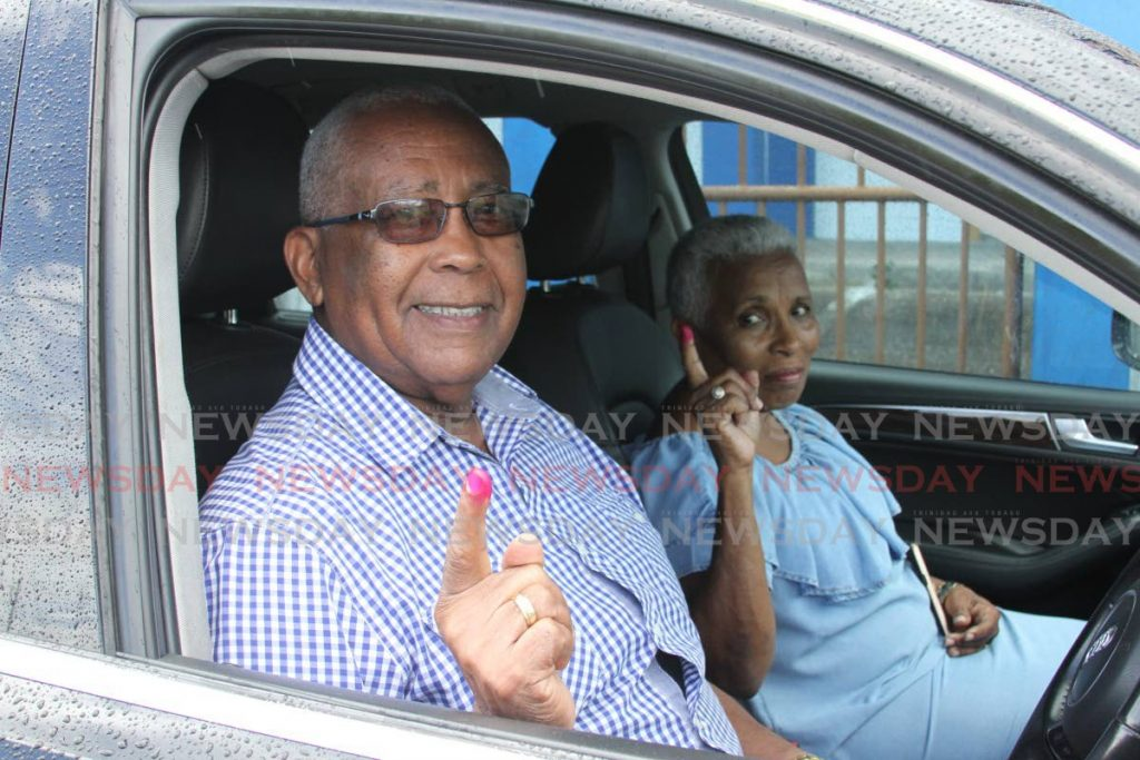 READY: Anthony Garcia and his wife after they voted in the 2015 general election. Garcia, the Arima MP, says he is willing to be the candidate once again in the upcoming general election. -