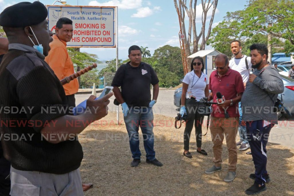 File photo- A security guard instructs members of the media to get off the compound of the San Fernando General Hospital during their coverage of covid19. - Marvin Hamilton