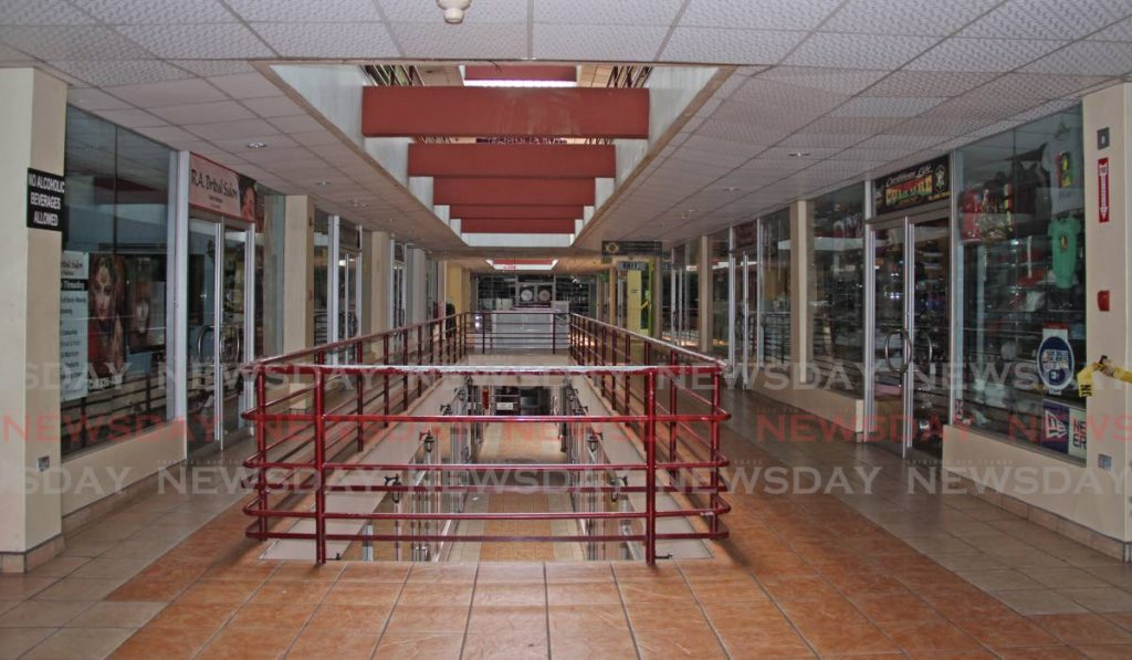 Stores remain shut at RRM Shopping Mall on High Street, San Fernando on April 24 due to covid19 restrictions. Business chambers hope the retail sector can reopen before June 7. PHOTO BY VASHTI SINGH -