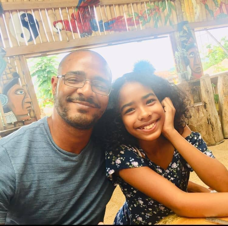 Mikaelah Dunn and her father Kenneth Dunn enjoys a meal at Flavaz Restaurant on a trip to Belize City.  - Photo Courtesy Kesha Dunn