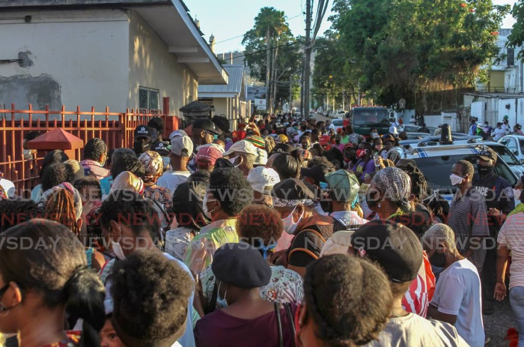 Hundreds of people who gathered outside the Living Water Community on Friday waiting for hampers had to be turned away by police as they breached social distancing regulations. - Ayanna Kinsale