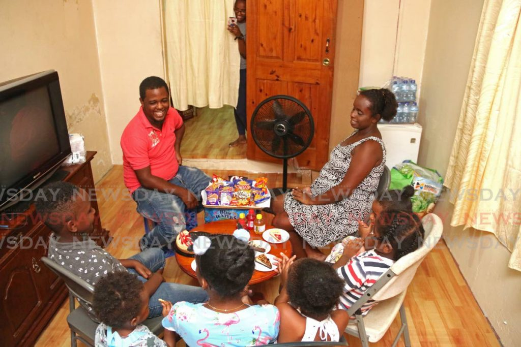Marcus Gibbs and his family at their temporary home in Petit Bourg as they celebrate the birthday of their eldest child last Thursday. - Marvin Hamilton