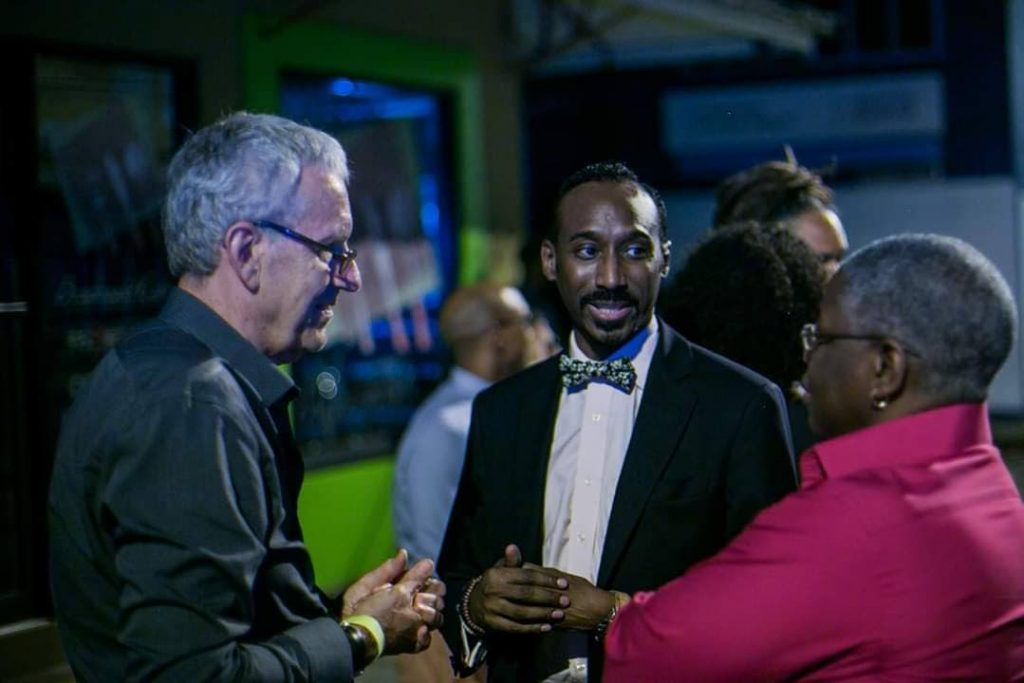 Nolan Frederick, centre, with founder and festival director of the TT Film Festival Bruce Paddington and journalist Franka Philip at the premiere of the TT Film Festival in 2015. - Photo courtesy TT Film Festival