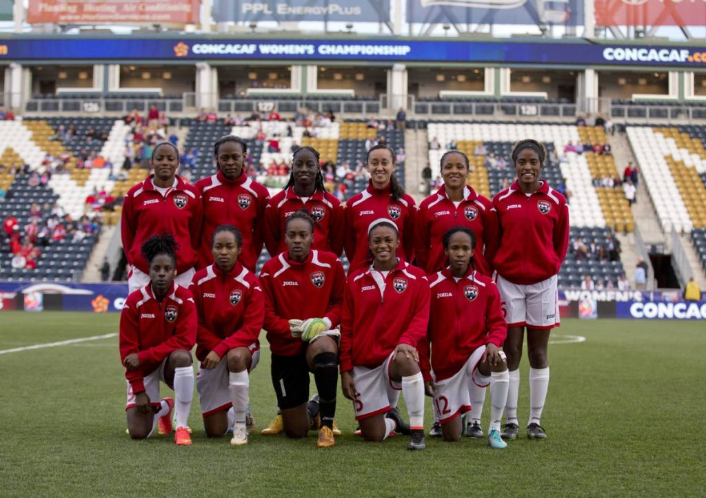 TT's women's team pose for a team picture prior to the game against Costa Rica in the 2014 Concacaf Women's Championship semifinal game on October 24, 2014 at  PPL Park in Chester, Pennsylvania.   (AFP PHOTO) - Mitchell Leff