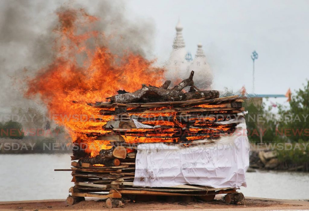 A Hindu cremation taking place at the Waterloo cremation site near the Siewdass Sadhu Shiva Mandir Temple in the Sea. - Lincoln Holder