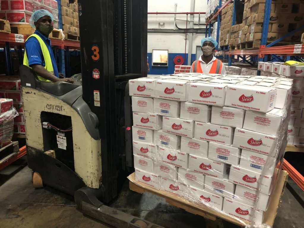 Swiss Ketchup being prepared to be delivered to the Living Waters Community, as part of the The Victor  and Sally Mouttet Foundation's food distribution drive.  -