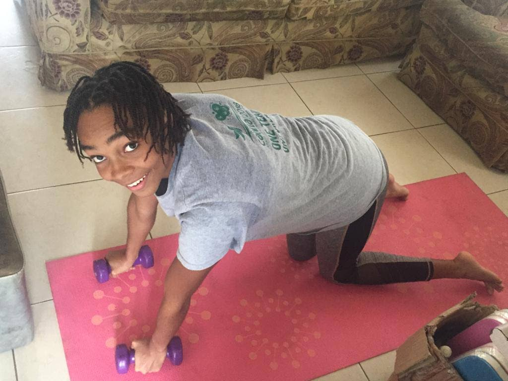 A Caribbean swimmer does physical training indoors using a growing virtual conference meeting targeting young swimmers.  -