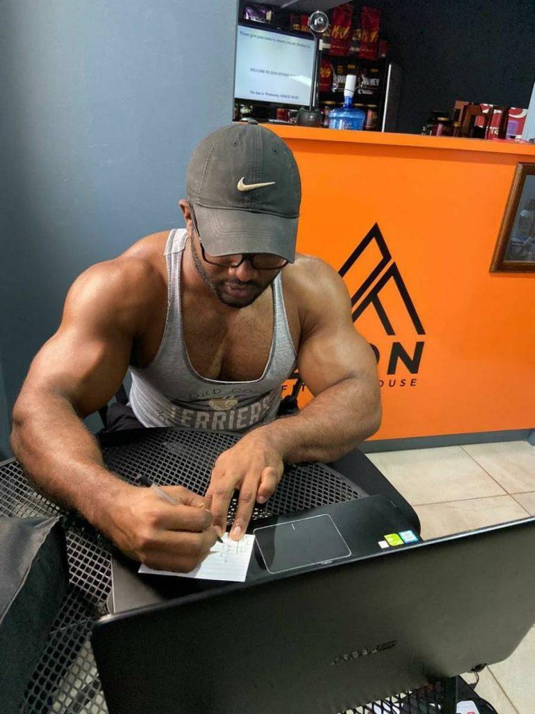 Iziah Kanhai communicating with client online from Zion Fitness in Chaguanas. - Photo courtesy Iziah Kanhai